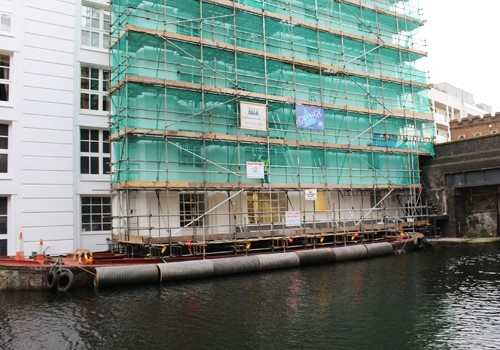 Sunken barge provides scaffolding solution for canalside offices